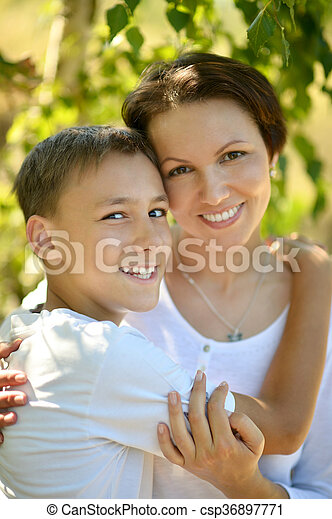 mother with son in park - csp36897771