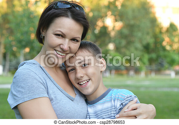 Mother with son in park - csp28798653