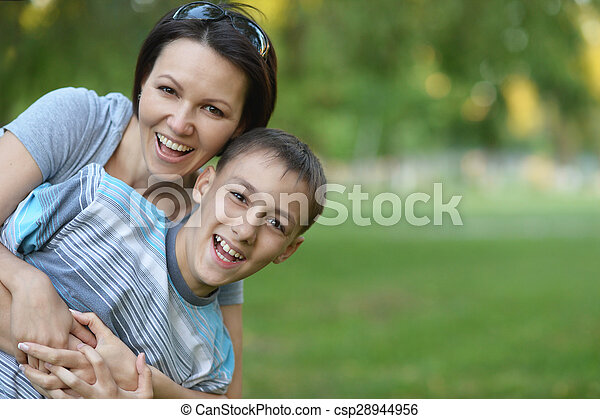 Mother with son in park - csp28944956
