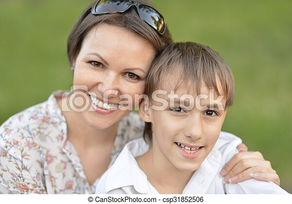 mother with son in park - csp31852506