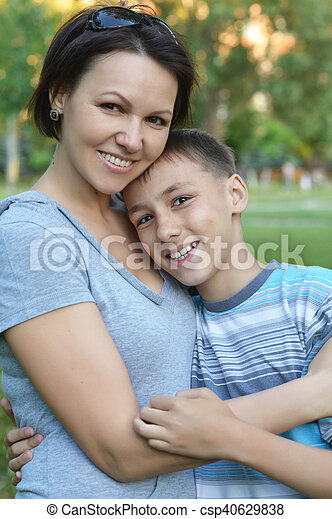 Mother with son in park - csp40629838