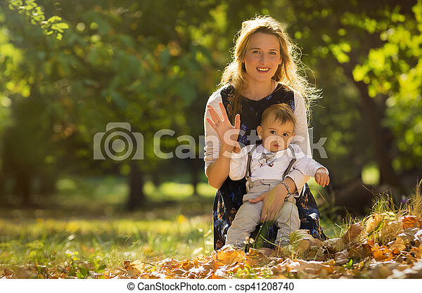 Mother with son playing in park - csp41208740