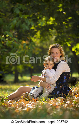 Mother with son playing in park - csp41208742