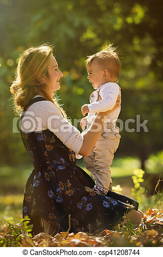 Mother with son playing in park - csp41208744