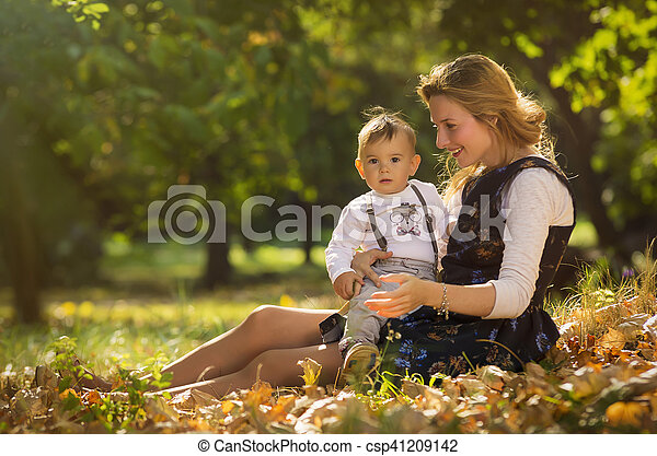 Mother with son playing in park - csp41209142
