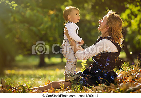 Mother with son playing in park - csp41209144