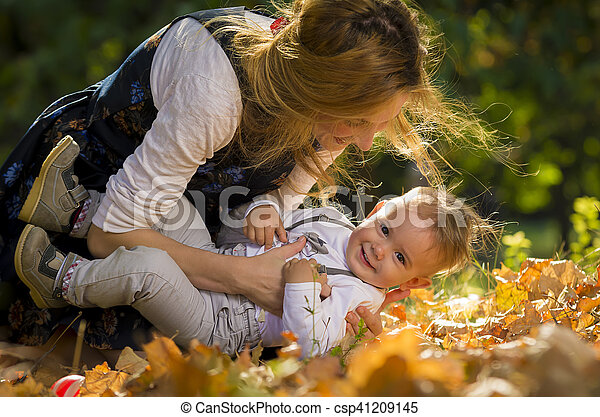 Mother with son playing in park - csp41209145