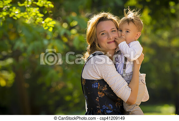 Mother with son playing in park - csp41209149