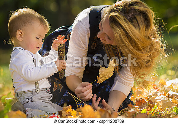 Mother with son playing in park - csp41208739
