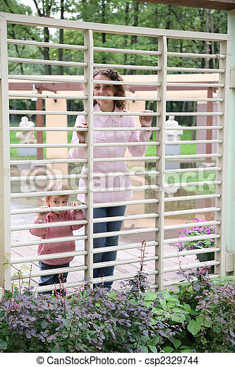 mother with the child in the park - csp2329744