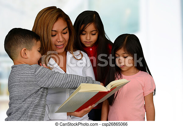 Mother with three kids reading - csp26865066