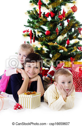 Mother with two children under Christmas tree - csp16659607