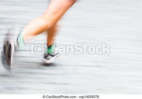 Motion blurred runner's feet in a city environment - csp14005078