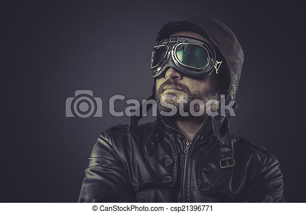 motivation pilot dressed in vintage style leather cap and goggle - csp21396771