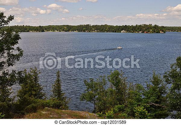 Motor boat on a lake - csp12031589