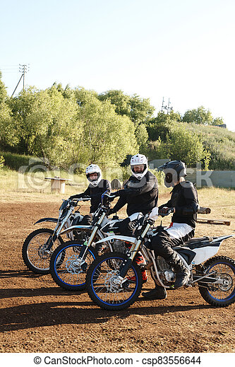 Motorcyclists talking before competition - csp83556644