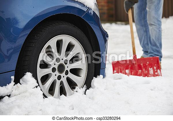 Motorist Digging Car Out Of Snow - csp33280294
