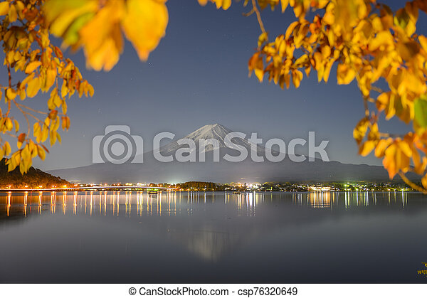 Mount Fuji view from lake Kawaguchiko the famous scenic attraction in Autumn - csp76320649