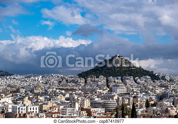 Mount Lycabettus and Athens cityscape view from Areopagus hill in Greece, blue cloudy sky - csp87410977