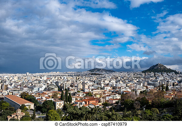 Mount Lycabettus and Athens cityscape view from Areopagus hill in Greece, blue cloudy sky - csp87410979