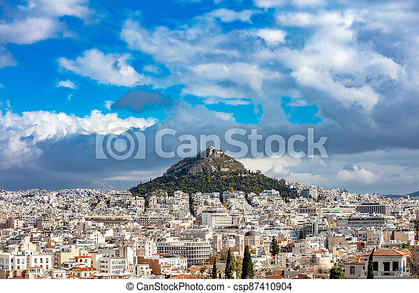 Mount Lycabettus and Athens cityscape view from Areopagus hill in Greece, blue cloudy sky - csp87410904
