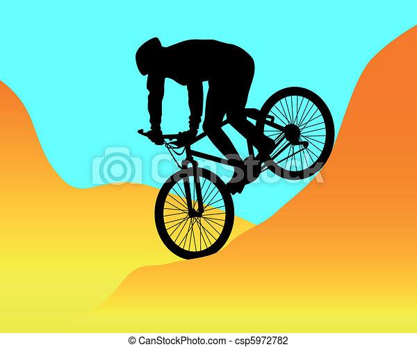 Mountain Biker Riding In The Mountains