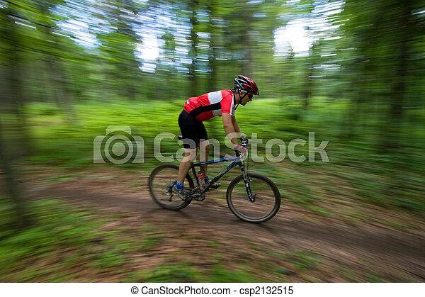 Mountain Biker with blurred background - csp2132515