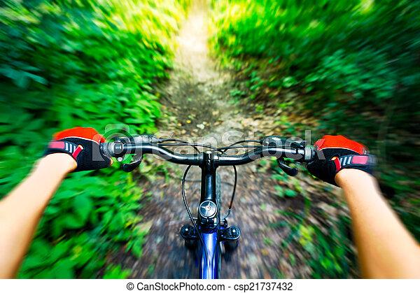 Mountain biking down hill. View from biker. - csp21737432