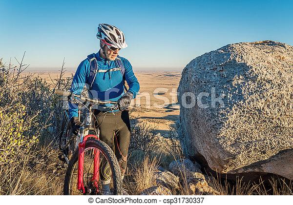 mountain biking in Colorado foothills - csp31730337