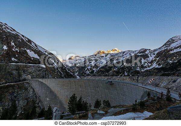 Mountain hydro dam in the morning. - csp37272993