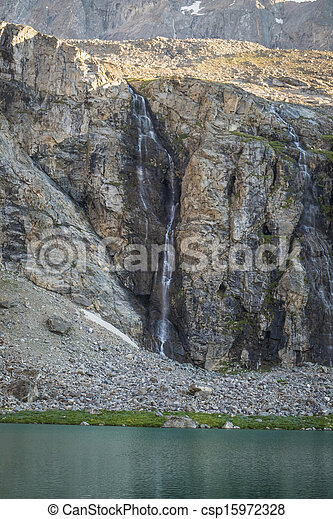 Mountain lake and waterfall - csp15972328