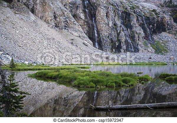 Mountain lake and waterfall - csp15972347