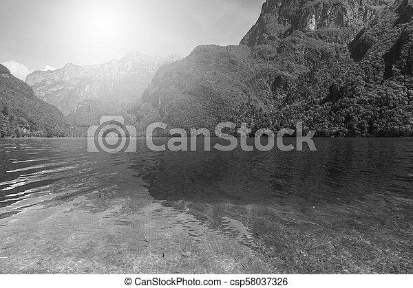 Mountain lake at sunrise - csp58037326