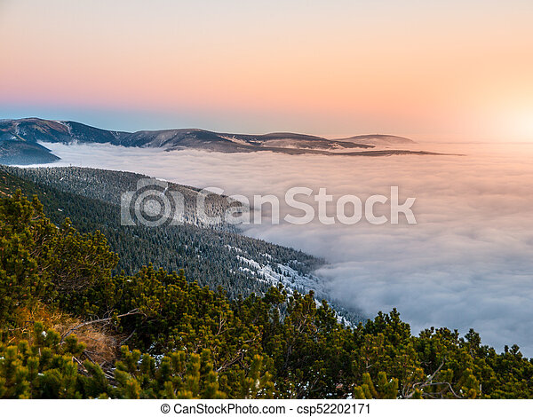Mountain landscape at sunset time. Freezy evening and weather inversion, Giant Mountains, aka Krkonose, Czech Republic.