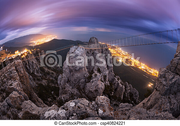 Mountain landscape with rising full moon at night - csp40824221