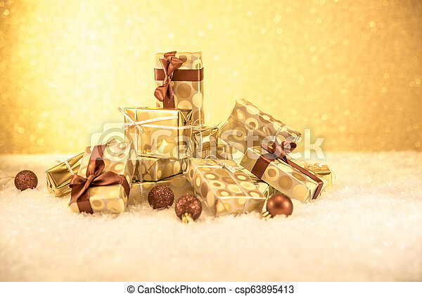 mountain of gifts with golden Christmas decorations - csp63895413