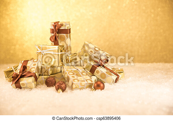 mountain of gifts with golden Christmas decorations - csp63895406