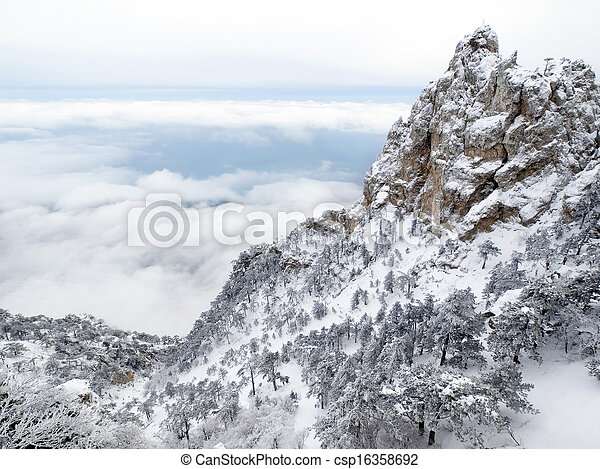 Mountain over clouds - wintry landscape. - csp16358692