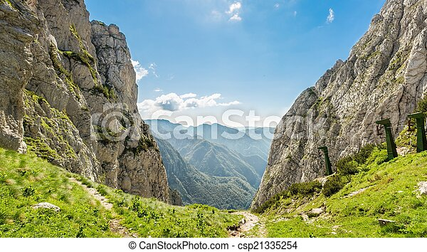 Mountain pass with a view of a valley - csp21335254
