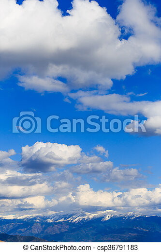 Mountain range with blue sky and clouds. - csp36791183