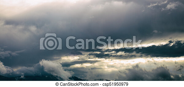 Mountain range with blue sky and heavy clouds. - csp51950979