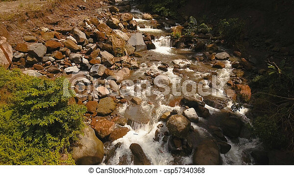 Mountain River in the rainforest. Camiguin island Philippines. - csp57340368