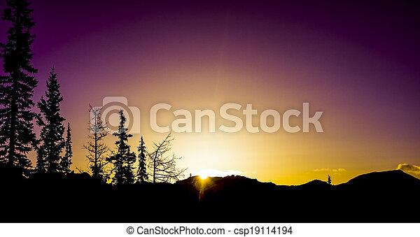 Mountain Sunrise silhouettes - csp19114194