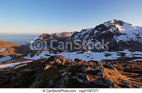 Mountain sunset panorama at autumn in Norway - csp21097371