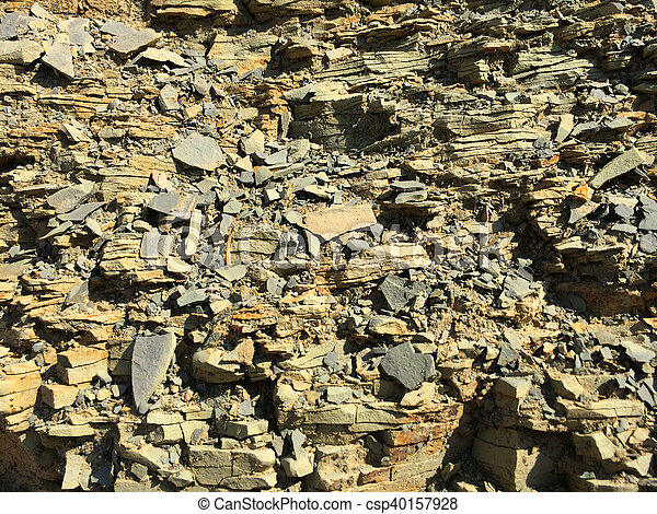16f7f80a4 Mountain textured rocky wall with scenic layered stone structure -  csp40157928