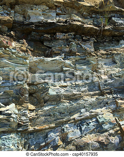 f9f758e8e Mountain textured rocky wall with scenic layered stone structure -  csp40157935