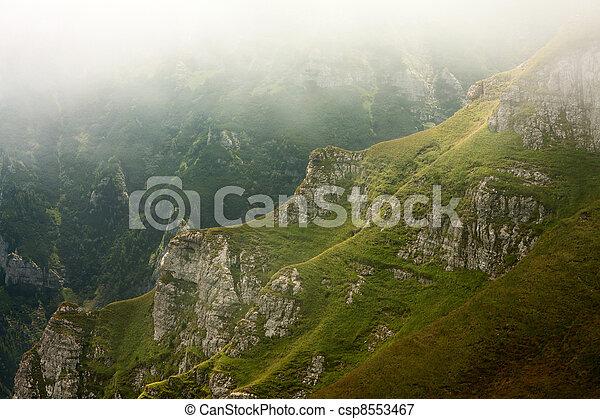 mountain valley in the mist, Bucegi Mountains, Romania - csp8553467