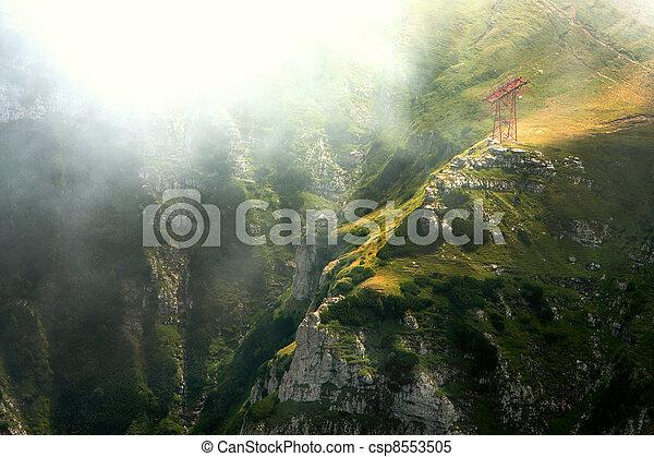 mountain valley in the mist, Bucegi Mountains, Romania - csp8553505