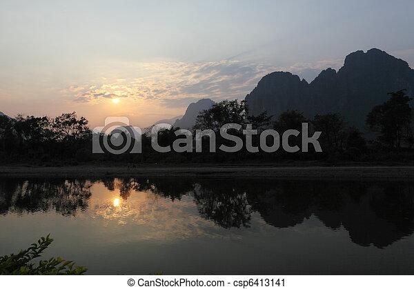 Mountains at Vang Vieng in Laos at sunset - csp6413141