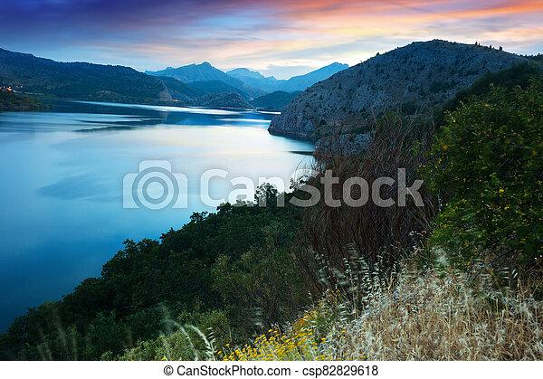 mountains lake in summer sunrise - csp82829618